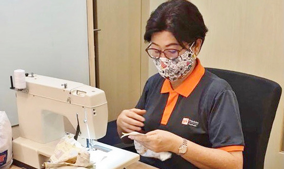 ​Tan Siam King siewing masks for charity. PHOTOS SINGHEALTH POLYCLINICS